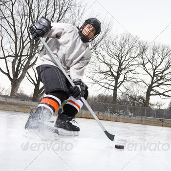 Boy playing ice hockey 1