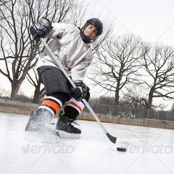 Boy playing ice hockey 1