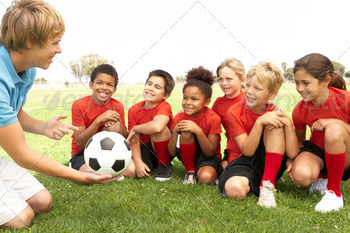 Young Boys And Girls In Football Team  With Coach 1